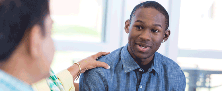 Young African American man receiving counseling