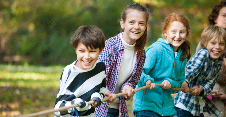 Children playing rope outdoors.